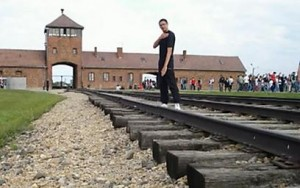 A Quenelle being photographed at Auschwitz. Photo: Screenshot.