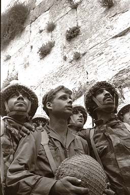 The iconic photograph of Israeli soldiers gazing at the Western Wall, in Jerusalem, for the first time in their lives, after entering the city as Israel beat the invading Arab armies in 1967. Photo: Israel Knesset.