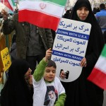 "During previous rallies marking the anniversary of the Islamic Revolution, Iranians are holding signs that read ""Down with America"" and ""Down with Israel."" Photo: Twitter, UN Watch."