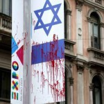 An Israeli flag was defaced with red paint to symbolize blood in Milan. PHOTO: La Republica