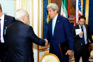 Secretary of State John Kerry shaking hands with his Iranian counterpart, Iranian Foreign Minister Javad Zarif. Photo: Wikimedia Commons.