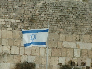 An Israeli flag at the Western Wall in Jerusalem. Israel has clearly emerged as the guarantor of the continuity of Jewish life, according to Isi Leibler. Photo: Wikimedia Commons.