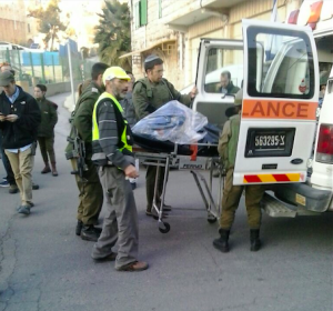 Israeli ZAKA volunteers at the scene of a stabbing attack in Hebron. Representatives from the Middle East Quartet met with Israeli officials to discuss ways to help end the current Palestinian terror wave in Israel. Photo: Courtesy ZAKA.