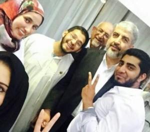 Aayesha J. Soni (top left) poses with Hamas leader Khaled Meshaal. Photo; Twitter.
