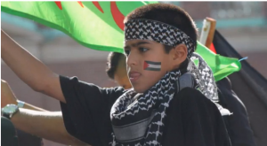 Child who addressed the Al Quds Day rally with Anti-Zionist hate speech. Photo: Screenshot.