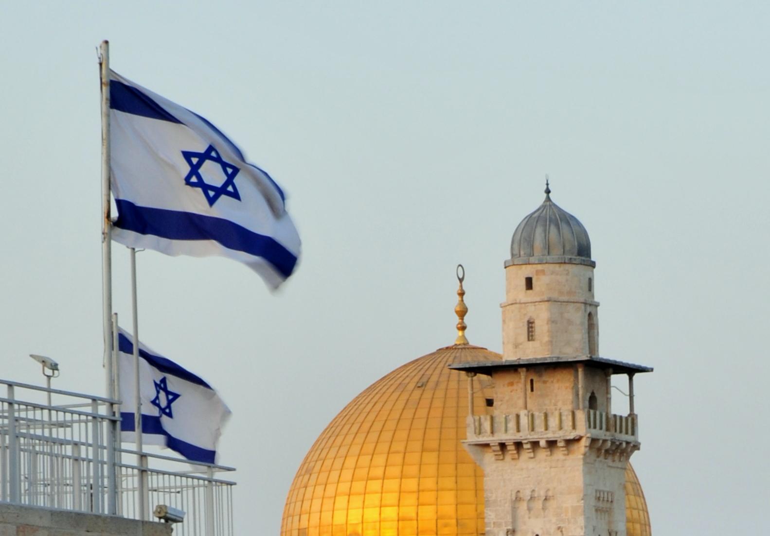 Israeli flags and Muslim minarets in Jerusalem's Old City. Photo: Dave Bender