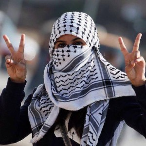 """A Palestinian woman making the victory sign. Photo: from the Facebook page, """"Palestine Belongs to Palestinians!"""""""