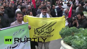 """Protesters in Iran hold banners that read """"Down with U.S.A."""" Photo: Screenshot."""