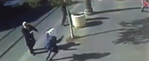 CCTV footage in Jerusalem shows stabbing attack, police subduing teenage assailants. Photo: Screenshot