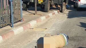 The Palestinian attacker, identified as Muhammad Zahran, after he was shot dead by an Israel security guard. Photo: Hatzalah.