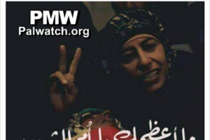 """In this photo published on the Facebook page of the Palestinian Fatah faction, the mother of late Palestinian terrorist Muhammed Shamasneh makes a """"V"""" sign with her right hand. The caption reads, """"How great you are, O mother of the Martyr."""" Photo: Palestinian Media Watch."""