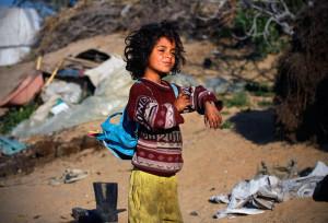 A child in Gaza, where underage labor is on a sharp rise. Photo: Wikipedia.