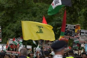 Hezbollah flag being flown during 2016's Al-Quds Day march in London. Photo: Steve Winston.