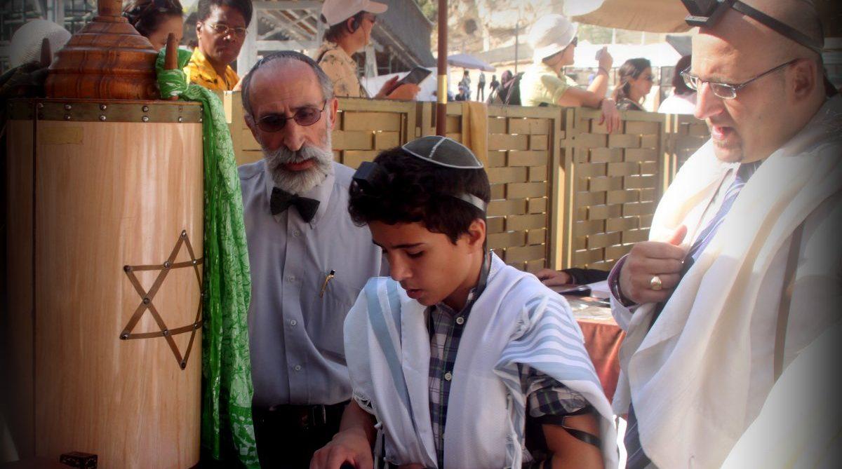 A bar mitzvah boy in synagogue. Wikipedia.